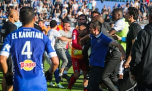 The Lyon goalkeeper Anthony Lopes is held back during an altercation with Bastia fans during the teams' subsequently abandoned Ligue 1 match.