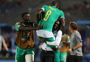 Aliou Cissé celebrates with Cheikhou Kouyaté after the goal that took Senegal to the final. He said it was disappointing that stadiums have been 'a little empty'.