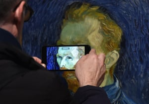 A visitor at the exhibition Van Gogh and Britain, at Tate Britain in London, UK