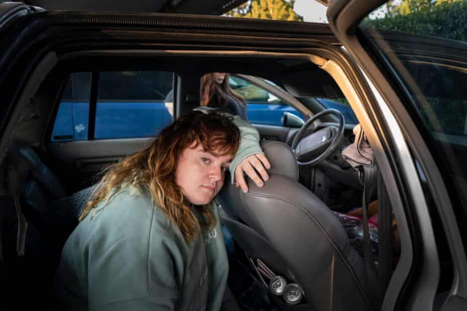 Sierra sits in their car parked outside their apartment in County, California. Sierra and Priscilla lived in their car for a short period of time before they were able to find help from Family Promise and live in their emergency shelter.