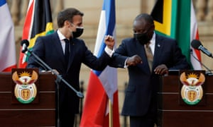 outh African president Cyril Ramaphosa (R), and his French counterpart Emmanuel Macron (L) bump elbows during a press conference at the government's Union Building, in Pretoria, South Africa, 28 May.