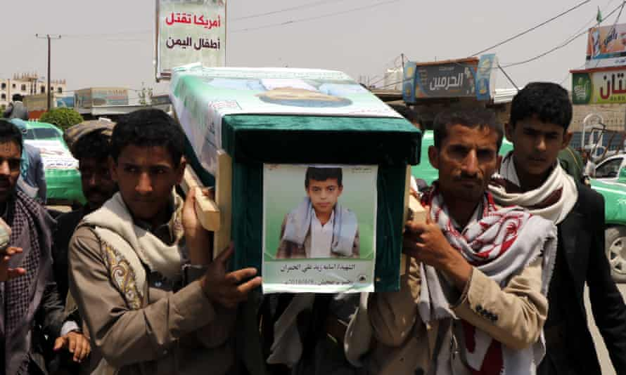Mourners carry the coffin of a child who was among 51 people killed by an airstrike on a bus in Yemen this month.