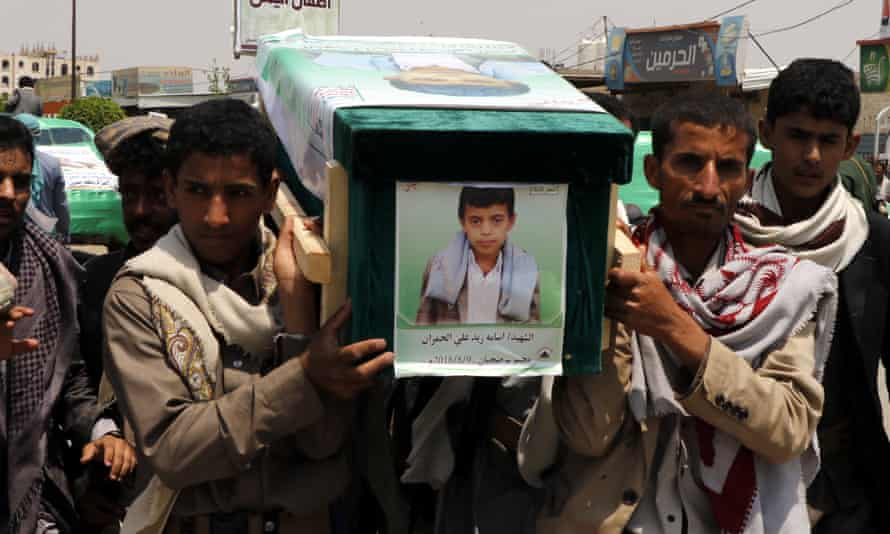 Mourners carry the coffin of a child at the funeral procession for those killed in an airstrike on a bus in Yemen.