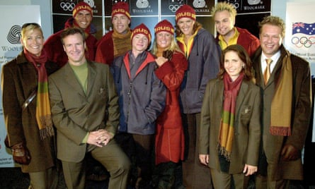 Past and present winter and summer Olympians model the 2002 Australian winter Olympic team uniform.