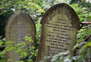 Ivy and other plants grow over the gravestones at Arnos Vale Cemetery in Bristol, England.