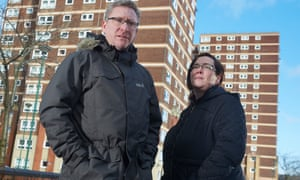 Richard Billingham and Deirdre 'White Dee' Kelly stand outside a tower block