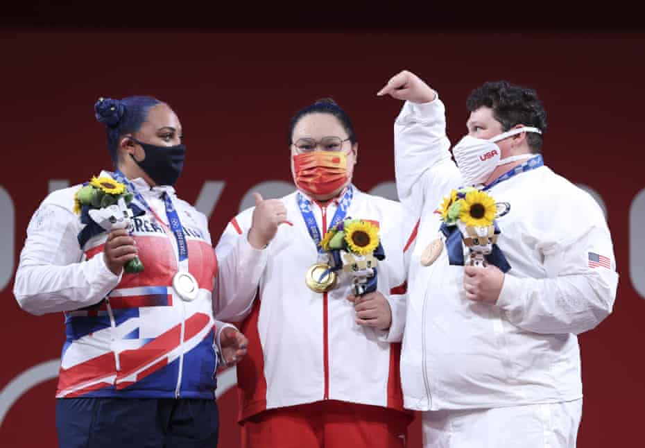 Emily Campbell of Great Britain, gold medallist Li Wenwen of China and bronze medallist Sarah Robles of the United States on the Olympic podium