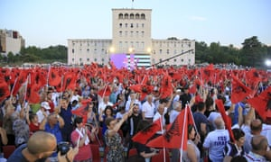 Supporters of the Socialist party wave Albanian national flags during the closing electoral rally in Mother Theresa square in Tirana