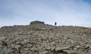 Walker approaching the summit of Scafell Pike - the highest mountain in England,