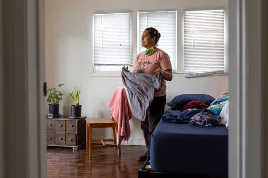 Loa Niumeitolu folds clothes in her bedroom on Friday, 11 December 2020, in Berkeley, California.