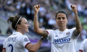 Dzsenifer Marozsán and Lucy Bronze celebrate Lyon's victory in the Champions League final.
