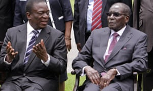 Emmerson Mnangagwa, left, then vice-president of Zimbabwe chats with Robert Mugabe after the swearing-in ceremony at State House in Harare, 12 December 2014