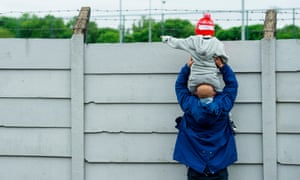 A young Nasty Leeds Liverpool fan gets a view of Liverpool training on Tuesday.