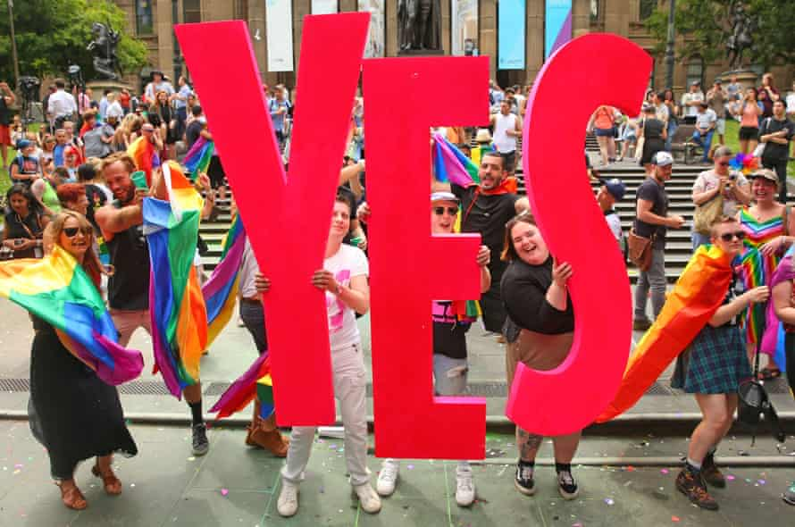 Marriage equality advocates in Melbourne celebrate as the result of the postal survey is announced.