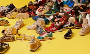 Pile of trainers against yellow background