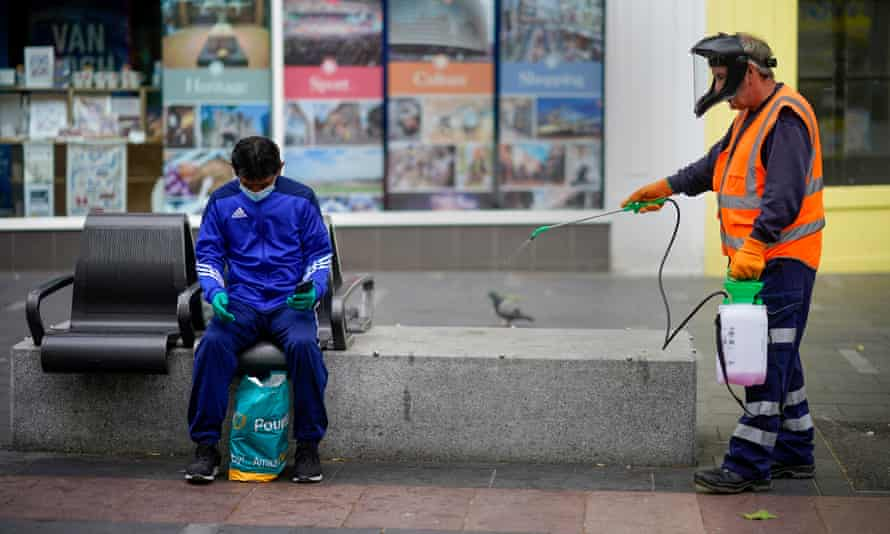 A council worker disinfects street furniture in Leicester.