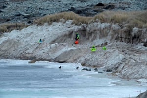 Zimbabweans work on a mined beach in Stanley