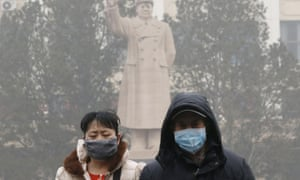 People wear masks as protection against acrid smog in Beijing. Authorities have introduced anti-pollution policies and have pledged to clean up the environment but the problem continues.