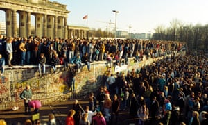 Blessed be the wall-destroyers … Berliners celebrate the end of the city's division in 1989 by the Brandenberg Gate.