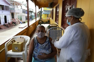 A health worker administers a vaccine in Anama, Amazonas state Brazil.