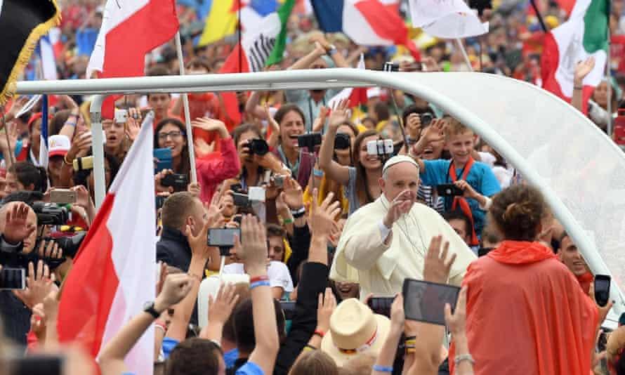 Pope Francis waves to pilgrims at Błonia park in Kraków