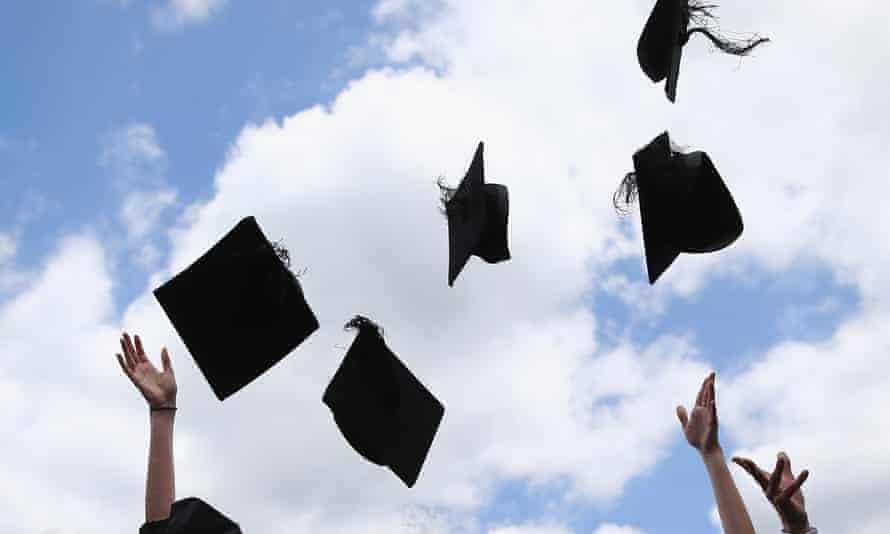 Graduates throw mortar boards