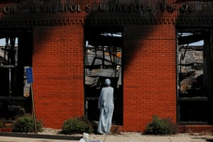 Man outside gutted building