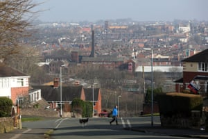 A man walks a dog in Stoke-on-Trent