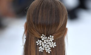Diamante snowflake hair accessories worn by models at Chanel