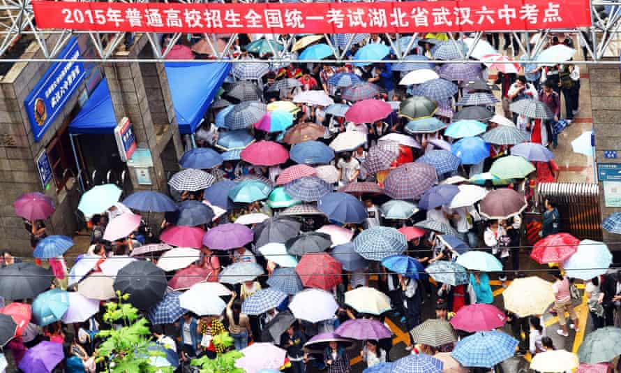 People holding umbrellas in Wuhan, China