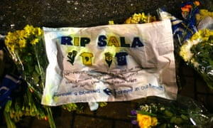 Tributes to Emiliano Sala are left outside the Cardiff City Stadium on Tuesday night.
