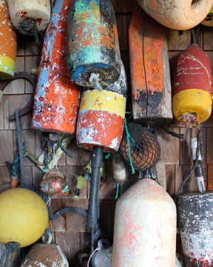 View of decorative buoys, a typical feature on the homes in coastal tourist villages on the Atlantic seaboard. These were located on a wall in Saint Andrews, New Brunswick, Canada.
