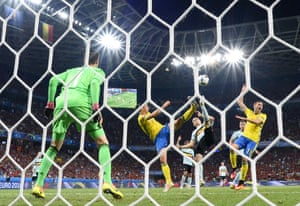 Sweden's Zlatan Ibrahimovic utilises his long legs to poke the ball past Belgium goalkeeper Thibaut Courtois, left, and into the net but the goal was disallowed.
