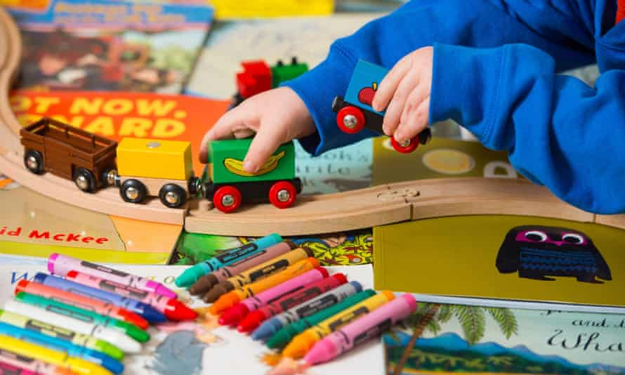 Toddler playing with toys in nursery