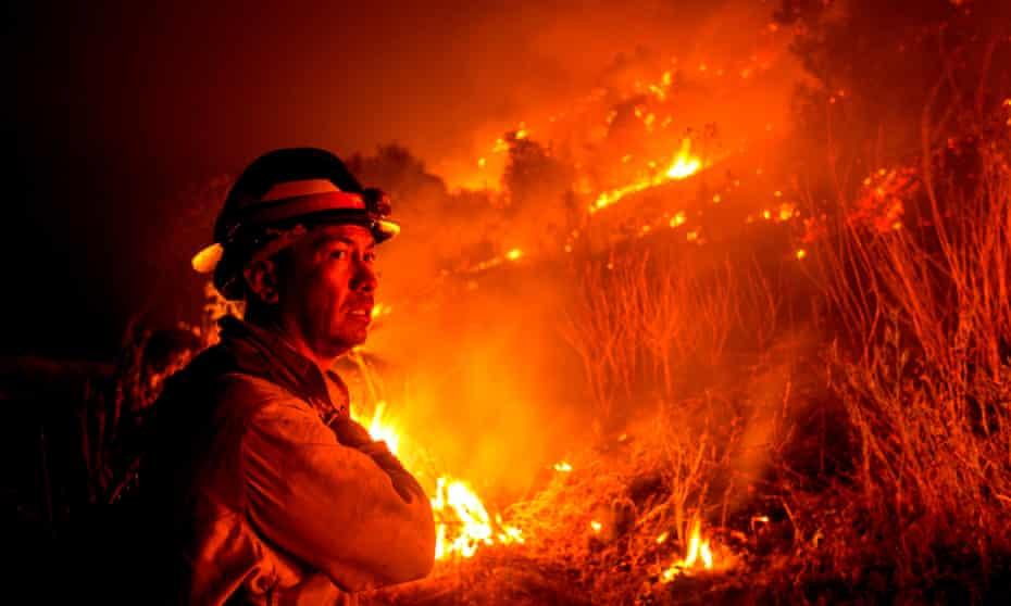 A firefighter watches the Bobcat fire in Monrovia, California, on 15 September.