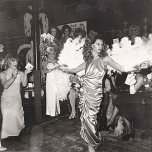 Nan Goldin: Naomi modeling in the beauty parade with fans, 1974