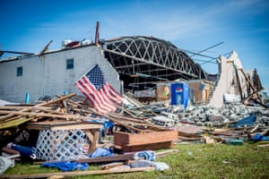 A US flag waves outside the collapsed 15th Street Flea Market in Panama City