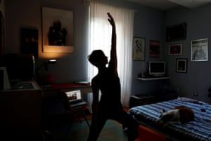 Francesca Valagussa, 40, practises yoga using an online course during the coronavirus lockdown in Rome, Italy
