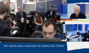 Sky News reporters conducting a meeting on a behind-the-scenes Sky News Raw broadcast.