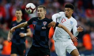 Jadon Sancho tries to win the ball for England