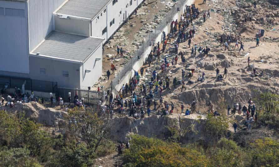 Looters raid a warehouse in Pinetown, Durban.