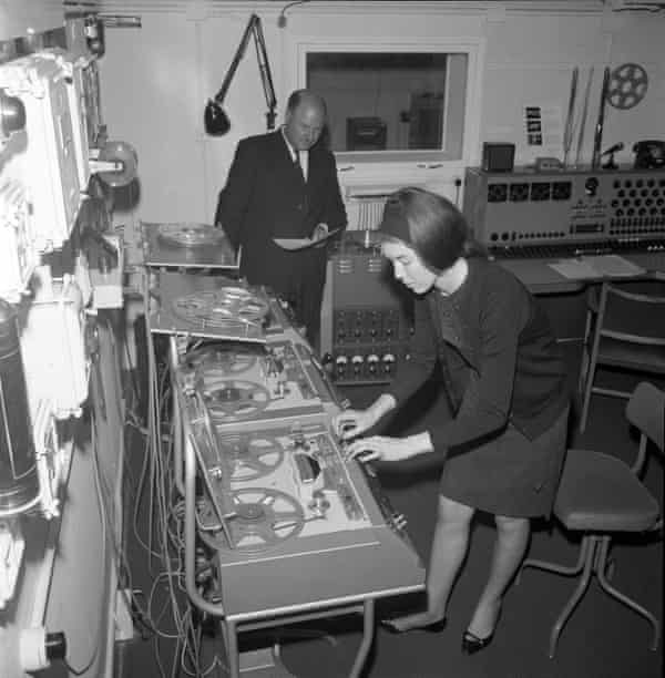 Delia Derbyshire, with Desmond Briscoe behind, at the BBC Radiophonic Workshop in 1965.