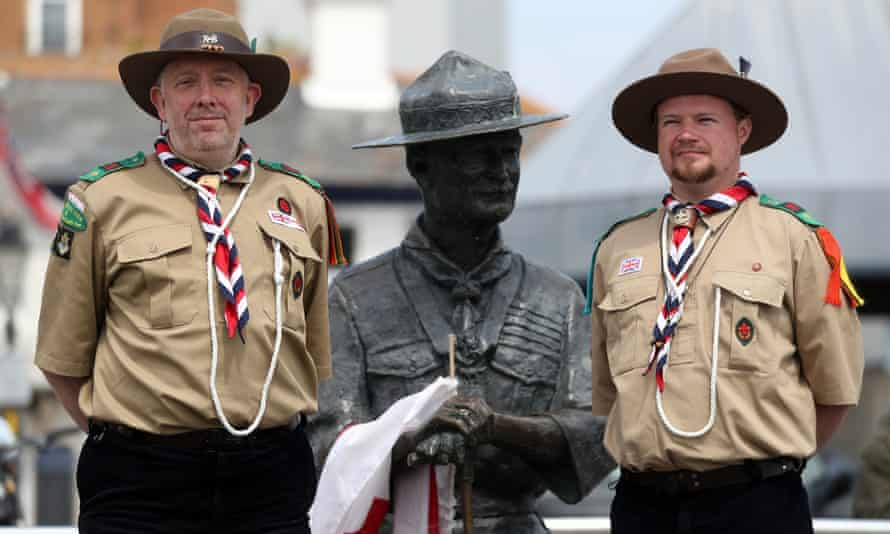 Rover Scouts Chris Arthur (left) and Matthew Trott with the statue of Robert Baden-Powell on Poole Quay in Dorset.