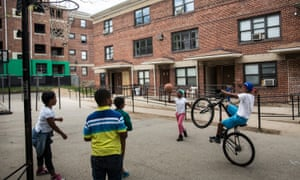 Kids play basketball at the Gilmor Homes on 2 May 2015 in Baltimore, Maryland.