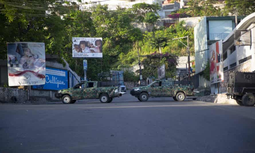 Military vehicles block the entrance to the neighbourhood where Jovenel Moïse lived
