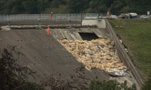 Engineers and members of the emergency services assess the damage to the Toddbrook reservoir dam above Whaley Bridge.