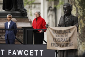 Theresa May delivers a speech as Mayor of London Sadiq Khan looks on during the unveiling