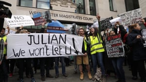 London, England Protestors demonstrate outside Westminster Magistrates Court