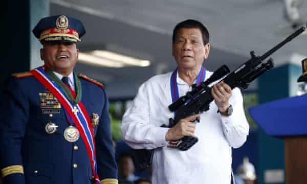 Rule of the strongman … the Philippines president Rodrigo Duterte poses with a rifle.