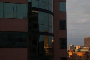 Reflections in windows opposite quarantine hotel